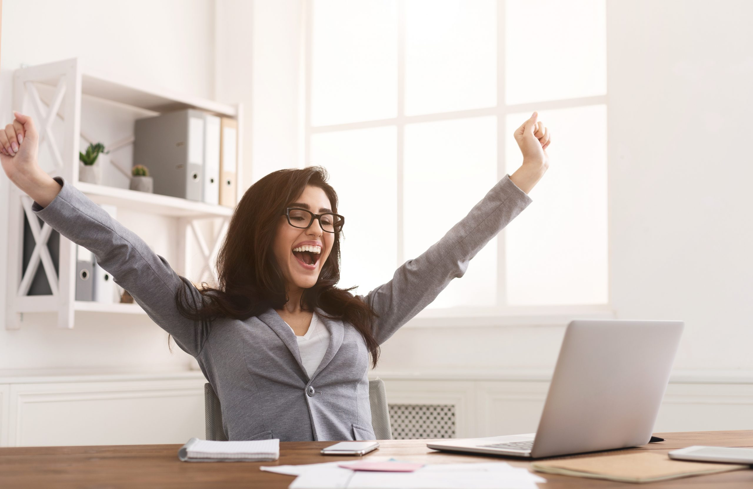 Yes! Happy Businesswoman Triumphing With Raised Hands